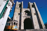 Streetcar in front of cathedral. Lisbon. Portugal