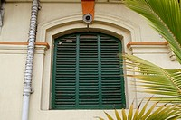 Green wooden shutters. Race course, Calcutta. India