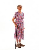 Full-length portrait of a smiling elderly Caucasian woman standing with a cane.