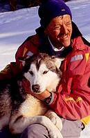 Michel Nicolier and his husky sleigh dogs. Les Fourgs, Doubs. Franche-Comté, France. (Model release)