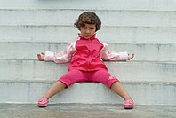 4 years indian baby girl sitting on the steps