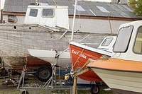 Boats pulled out and stored in a yard at Gairloch Harbour. Wester Ross, Highland, Scotland