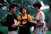 Three students in discussion, Malaysia