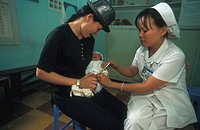 A HOSPITAL IN ASIA<BR>Photo essay from hospital.<BR>Tu Du maternity ward in Saigon, Vietman. Vaccinations in the pediatirc unit.