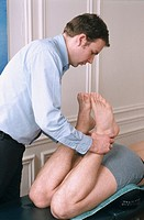 CHIROPRACTICE<BR>Photo essay.<BR>Chiropractor adjusting patient.
