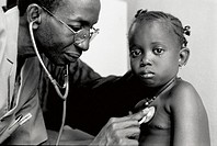 A HOSPITAL IN AFRICA<BR>Photo essay.<BR>Mali. Cardiologist at Bamako auscultating child with congenital heart disease. Child is awaiting operation by ...