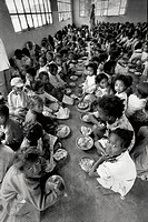 MEDICINE IN MADAGASCAR<BR>Photo essay.<BR>Father Pedro feeds 2500 lunches to children each day at Antananarivo, Madagascar.