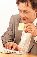 MAN WITH HOT DRINK<BR>Model.