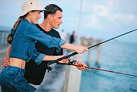 couple fishing from a pier