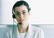 Woman wearing headset, portrait