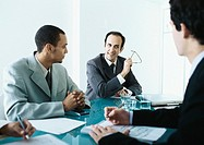 Business people sitting around table having meeting