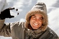 Man holding a snowball