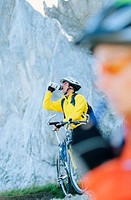 Cyclist drinking from bottle
