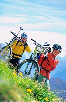 Carrying bikes across hillside