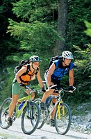 Two cyclists riding together