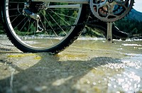 Cyclist crossing stream