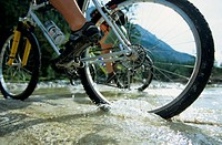 Cyclists crossing stream