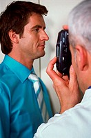 Doctor photographing patient