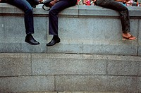 People sitting on wall