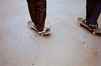 Two boys skateboarding