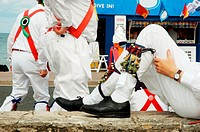 Morris dancers relaxing