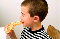 Boy eating a slice of pizza (thumbnail)