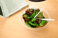 Bowl of salad on desk
