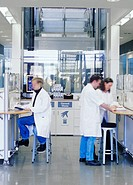 Laboratory research. Three workers in a research laboratory.