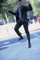 man jumping in the street