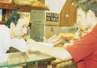 men in a delicatessen shop