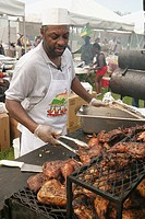 Jamaican Jerk Festival, man cooking chicken. C. B. Smith Park, Pembroke Pines. Florida. USA.