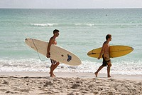Surfers and small waves. Atlantic shore, South Beach. Miami Beach. Florida. USA.