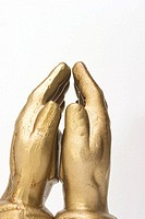 Gold hands in prayer position or healing or energy work