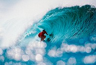 Hawaii, Oahu, North Shore, Pipeline, Shimmering water in foreground of Liam in wave curl