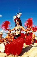 Tahitian dancers performing with Tahitian drummers on beach