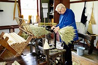 Making brooms for sale from special local straw at Historic Shaker Village of Pleasant Hill Kentucky KY