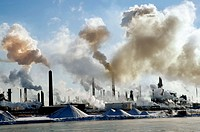 Chemical industry on the banks of the St Clair River at Port Huron Michigan spews smoke which can form acid rain