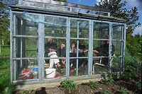 People sitting in a greenhouse  Sweden