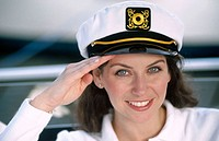 girl in a boating cap saluting