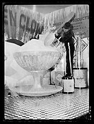 A photograph of a boy with a giant ice cream display, taken by Tomlin for the Daily Herald newspaper on 29 January, 1936.   The ice cream formed part ...