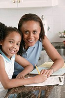 Mother and daughter doing homework, portrait