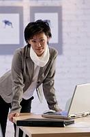 Businesswoman with laptop, portrait.
