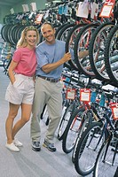 Couple in bike shop, portrait