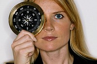 Woman holding compass