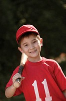 Boy with baseball gear, portrait