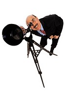 Businessman looking through telescope, portrait