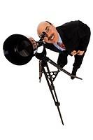 Businessman looking through telescope, portrait