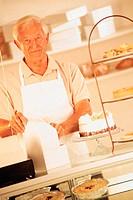 Man behind bakery counter