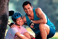 Couple outside wearing cycling gear, portrait