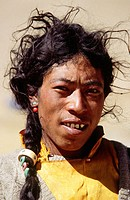 Portrait of one young to middle-aged Himalayan herder with black oily messy hair, Tibet, China